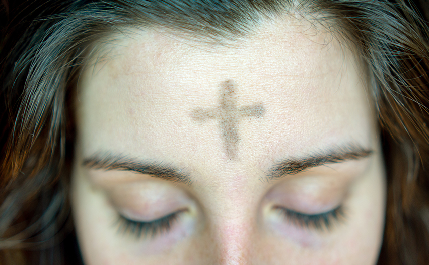Ash Wednesday, woman with cross on forehead